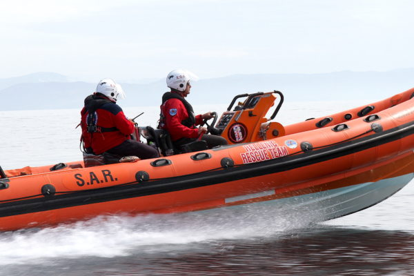 hellenic rescue volunteers respond to yacht emergency at sea