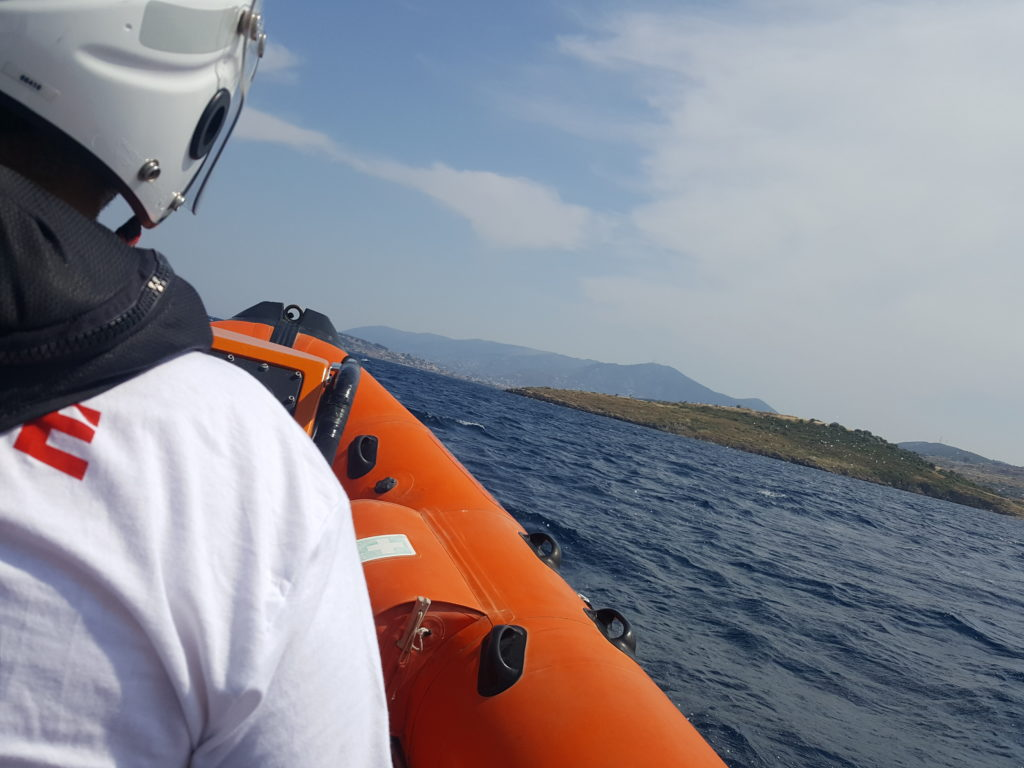 Hellenic rescue team respond to people on a rocky island