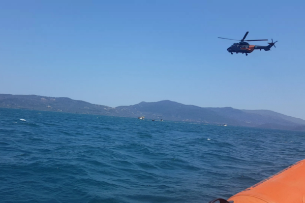 Hellenic rescue team respond to people in the sea emergency