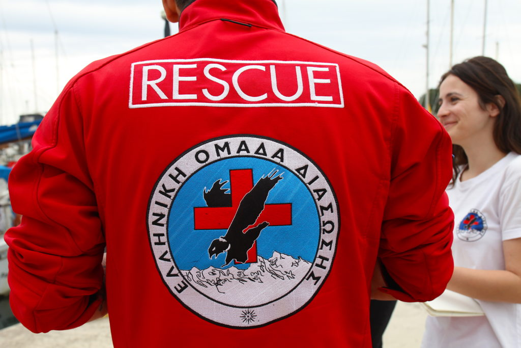 hellenic rescue team assist sailing ship in trouble at sea